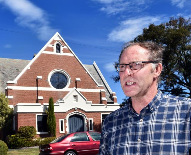 Heritage developer Stephen Macknight outside the Maori Hill church he says should be saved from demolition. Photo: Peter McIntosh