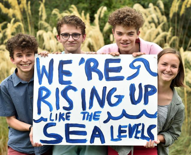 Logan Park High School pupils (from left) Zak Rudin (16), Finn McKinlay (17), Abe Baillie (16) and Linea Simons (16) prepare to strike for action on climate change. Photo: Peter McIntosh
