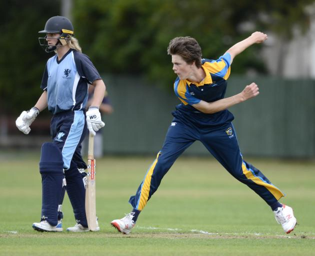 Wakatipu High School's Toby Hart  follows through after bowling a ball in the Gillette Cup regional semifinal at Tonga Park yesterday. King's High School's Mike Flanagan watches on. Photo: Gerard O'Brien