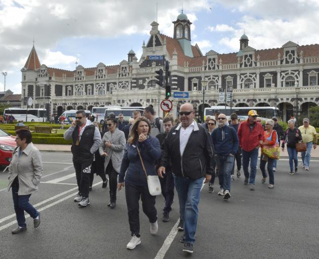 Passengers head in to the city from the Dunedin Railway Station after the Ovation of the Seas and the Golden Princess arrived in Dunedin yesterday. Photos: Gerard O'Brien