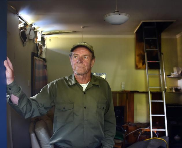 Back in his fire-damaged Dunedin home two months on from a suspected arson is Trevor Diehl. Photos: Peter McIntosh
