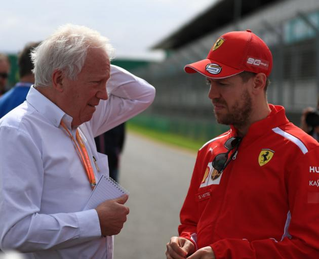 Charlie Whiting talks to Sebastian Vettel yesterday ahead of the season-opening Australian Grand...