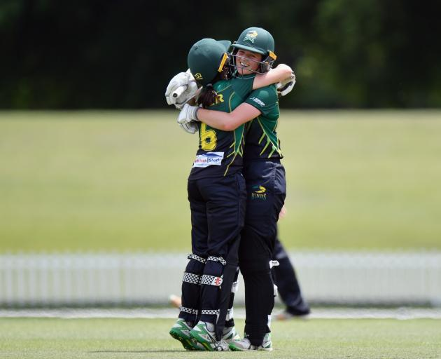 Anlo van Deventer and Kate Baxter celebrate in the middle. Photo: Getty Images