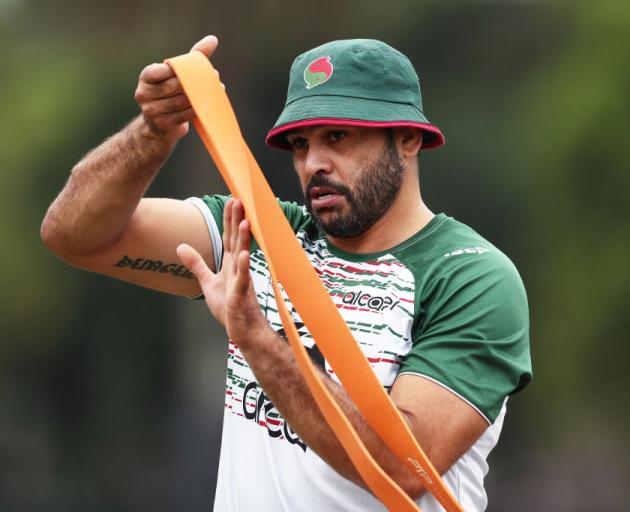 Rabbitohs back Greg Inglis takes part in a drill during a pre-season training session at Redfern Oval in Sydney last month. Photo: Getty Images