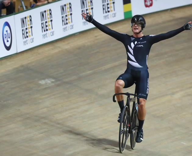 Campbell Stewart celebrates winning the world title in the omnium. Photo: Getty Images