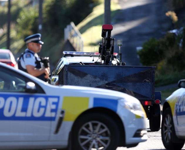 A bomb disposal robot arrives as police investigate a property at Somerville Street. Photo: Getty...