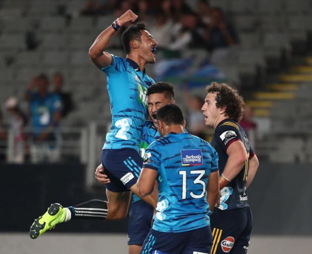 Melani Nanai celebrates a Blues try with Rieko Ioane and TJ Faiane during their win over the...