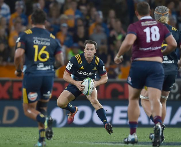 Highlanders co-captain Ben Smith looks to clear the ball.
