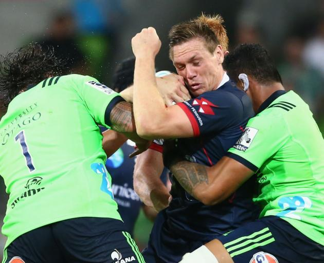 Dane Haylett-Petty of the Rebels is tackled during the round three Super Rugby match between the Rebels and the Highlanders. Photo: Getty Images
