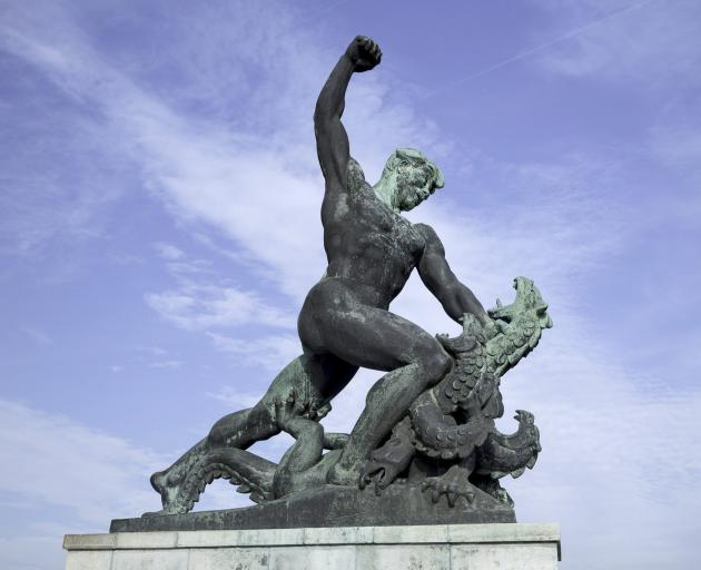 A bronze statue of a mythological figure fighting a dragon at Citadel Fortress, Gellert Hill, in...
