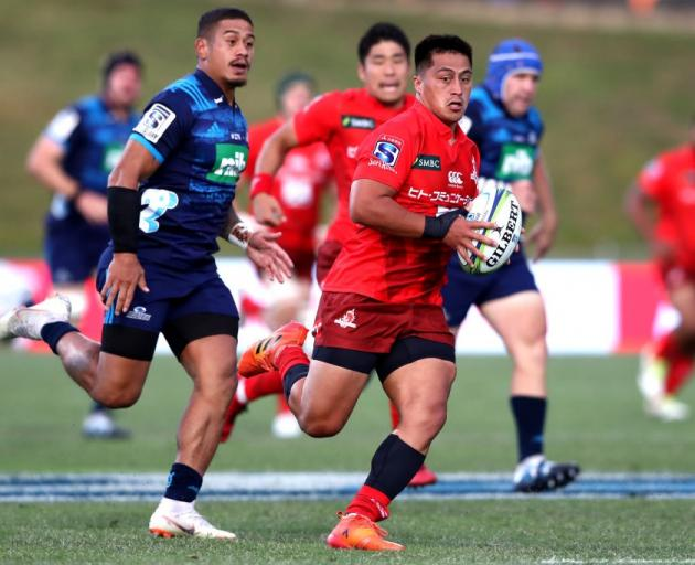 Jason Emery on the run for the Sunwolves against the Blues earlier this season. Photo: Getty Images
