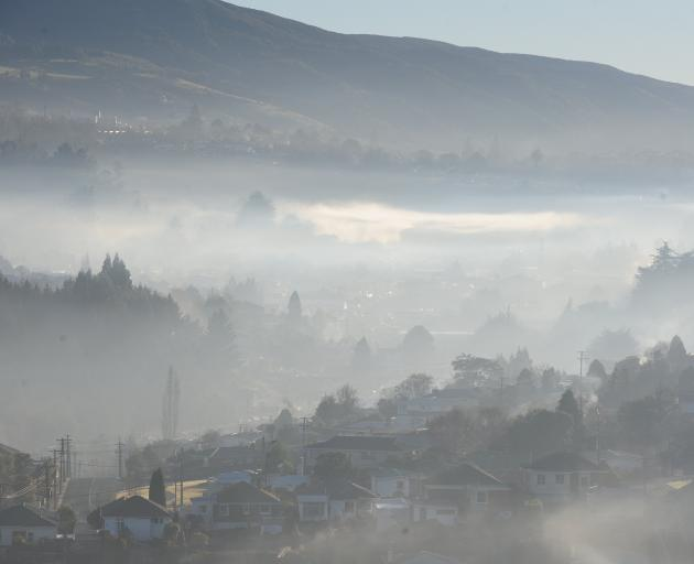Smog hangs over Kaikorai Valley on a Monday morning. Photo: ODT files