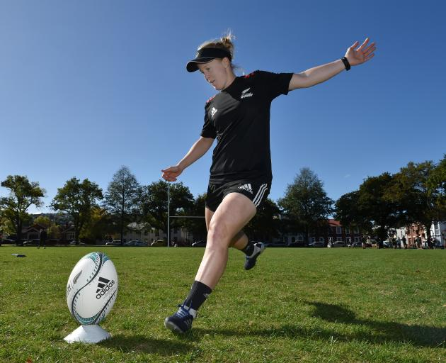 Black Ferns halfback Kendra Cocksedge boots a ball during a kicking session  at the North Ground