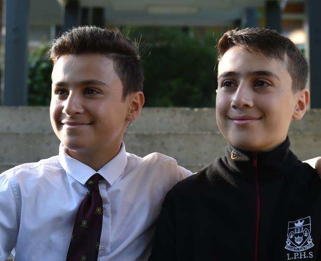 Jordanian brothers Ala'a (left) and Mohammed Mayyas celebrate Race Unity Day at Logan Park High School. Photos: Gregor Richardson