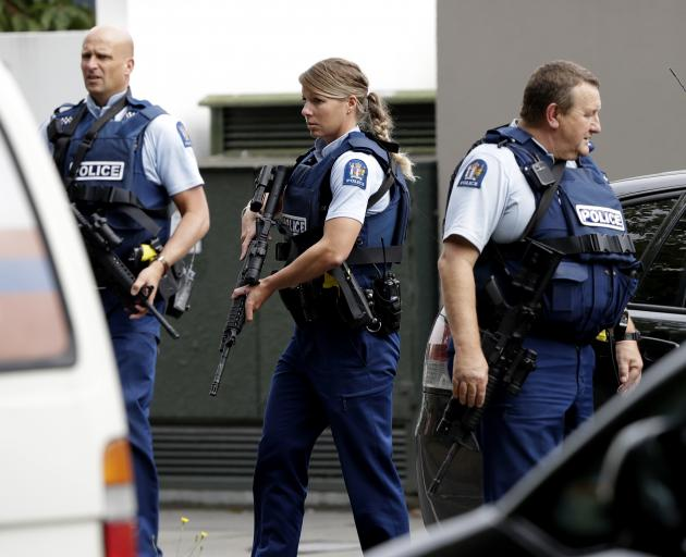 Armed police patrol outside a mosque in central Christchurch. Photo: AP