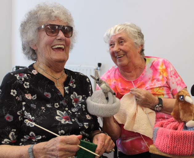 Isabelle Goodare and Helen White are among the Blind Foundation's knitters and will sell their beanies at Orphans Aid Opshop in Invercargill. Photos: Luisa Girao