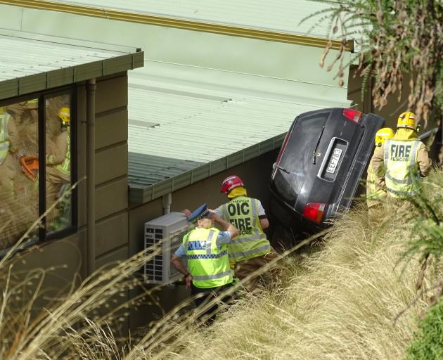 The woman was trapped for several hours between an embankment and a building on Gorge Rd. Photo:...