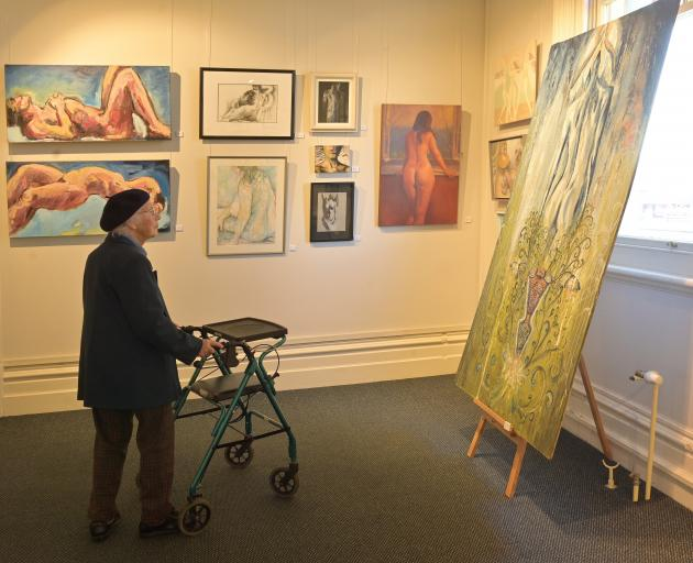 Honor McKellar, a resident of the Yvette Williams Retirement Village, appreciates art at The Nude...