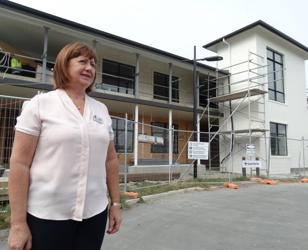Observatory Village Lifecare general manager Rosie Dwyer stands outside its future two-storey, 10...