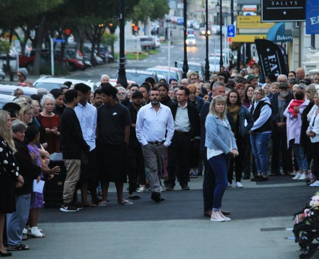 After a short vigil at St Luke's Anglican Church more than 100 people walked down Lower Thames St...