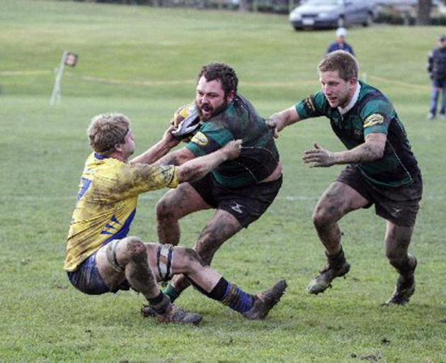 Maheno No 8 Hayden Tisdall tries to hold off Valley flanker Cameron Rowland during a Citizens...