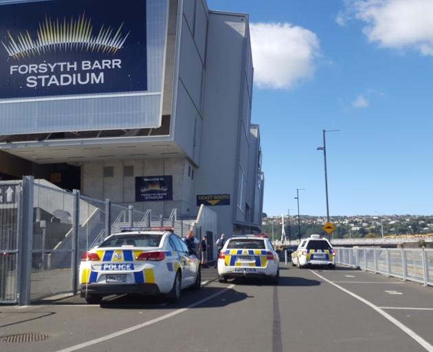 Police outside Forsyth Barr Stadium following an incident today. Photo: David Loughrey