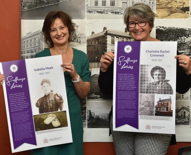 Heritage NZ assessment advisers Susan Irvine (left) and Sarah Gallagher show posters telling the lives of Otago-Southland signatories of the great Suffrage Petition of 1893, which will be on show at this weekend's Wanaka A&P Show. Photo: Gregor Richardson