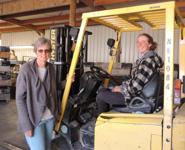 Julie Watt checks in with her eldest daughter, Irene Passadore, in the packing shed. Photo: Sally Brooker