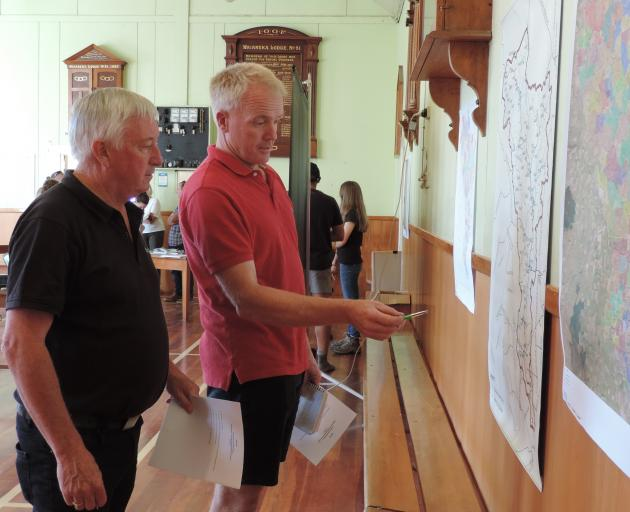 Noslam co-ordinator Rob McTague (left) and chairman Peter Mitchell discuss the map showing where testing will be carried out in the Waiareka catchment. Photo: Sally Brooker