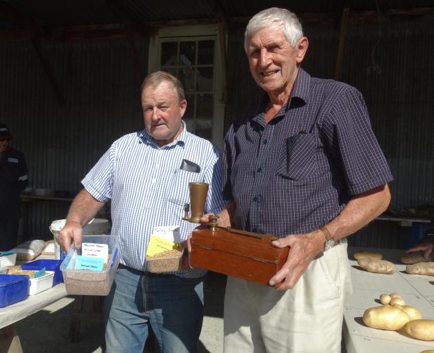 Lindsay Green (right), in the seeds shed with Temuka farmer Warren Stratford, at the recent Temuka and Geraldine A&P Show. Mr Green has been attending the show as a judge for more than 30 years. Photo: Chris Tobin
