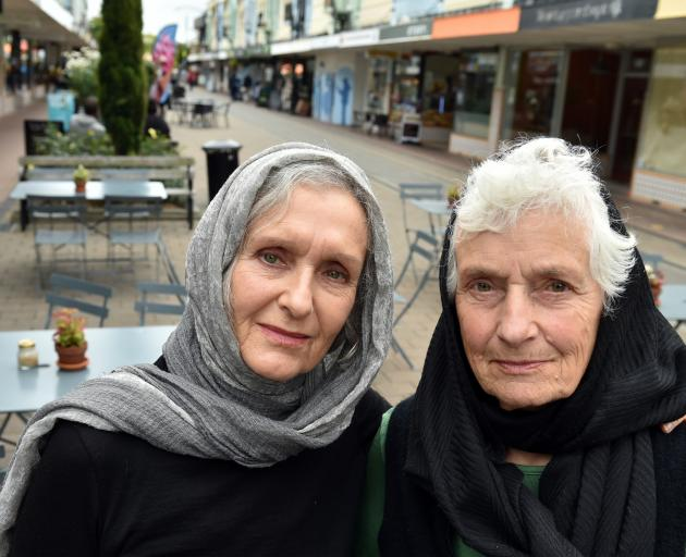 Alison Gilmore (left) and Caroline Maze wear headscarves in Christchurch yesterday afternoon, to show solidarity with the Muslim community after the Friday mosque shootings. Photos: Gregor Richardson