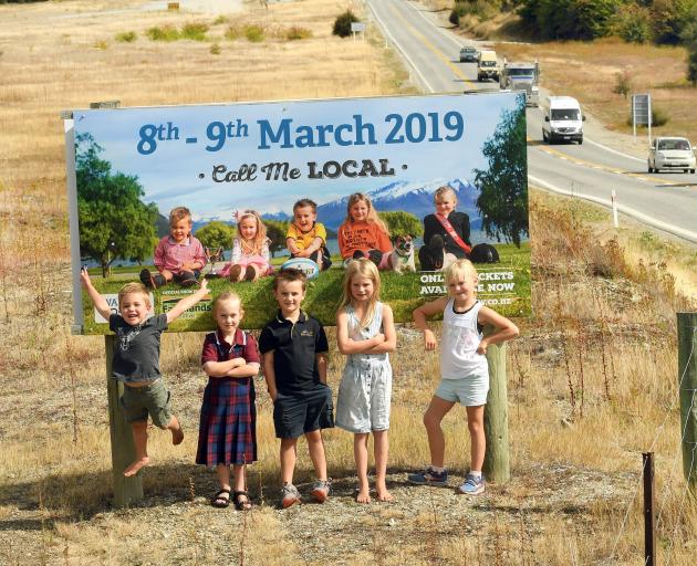 TYhe faces of Wanaka's A&P show are (from left) Angus Scurr (4), Charlotte Crosbie (5), Hunter...