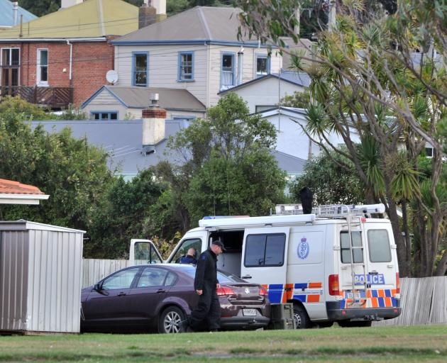 Police outside an  address in Somerville St Dunedin. Photo: Christine O'Connor