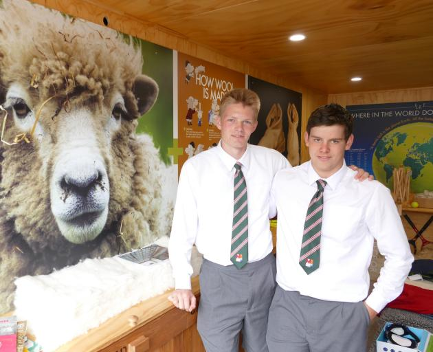 Luke Humphries (17, left), of Tuturau, and Luke Goatley (17), of Venlaw, stand beside one of the exhibits in The Wool Shed. Photo: Ken Muir