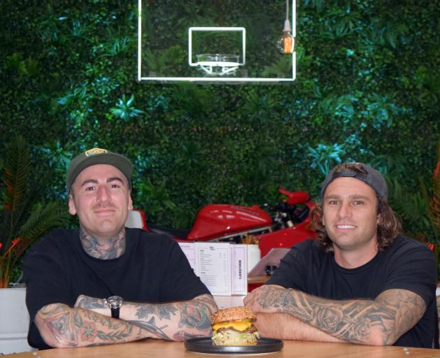 Burger sales have doubled in a week for Dunedin eatery Good Good co-owners Reece Turfus (left) and Rob Ratten. Photo: Shawn McAvinue