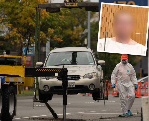 Accused mosque gunman Brenton Tarrant's car, with bullet holes in the windscreen, is removed from...