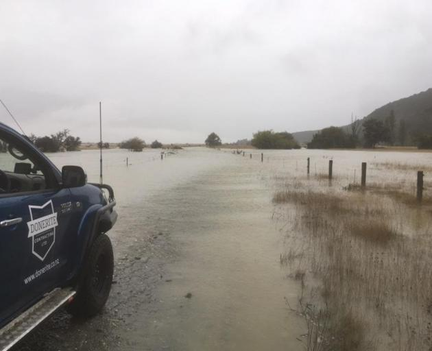 Part of the Glenorchy-Paradise Rd was closed due to surface flooding yesterday. PHOTO: DOWNER