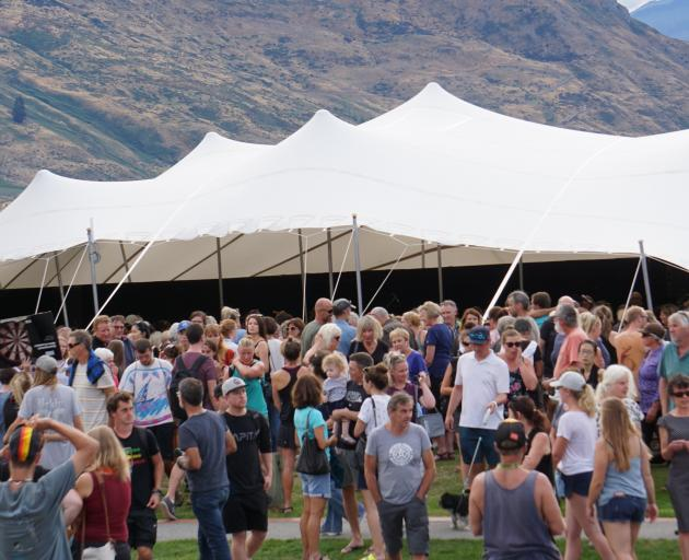 At least 1500 people gathered on the Lake Wanaka foreshore to remember those who lost their lives in Friday's terrorist attacks. Photo: Sean Nugent