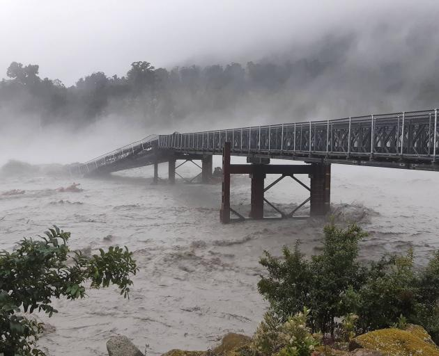 Much of the West Coast is cut off after a section of the Waiho River bridge was swept away. Photo: Civil Defence/West Coast Emergency Management