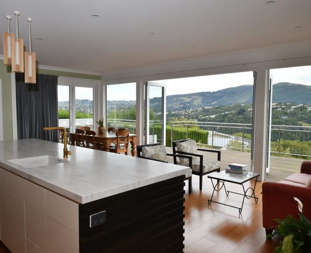 The open-plan living area has sweeping views and leads out to about 80sq m of decking.