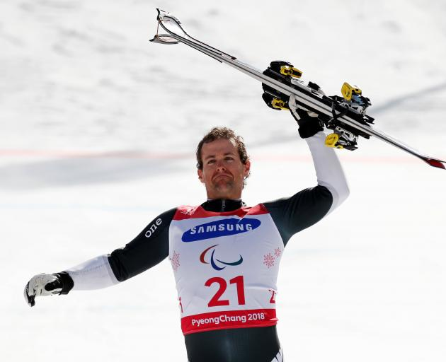 Adam hall celebrates his gold medal in the standing skiing. Photo: Reuters