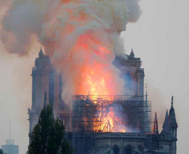 Smoke billows from Notre Dame Cathedral after a fire broke out. Photo: Reuters