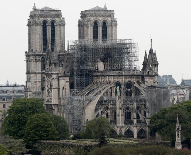 AFTER: A view shows Notre-Dame Cathedral after a massive fire devastated large parts of the...