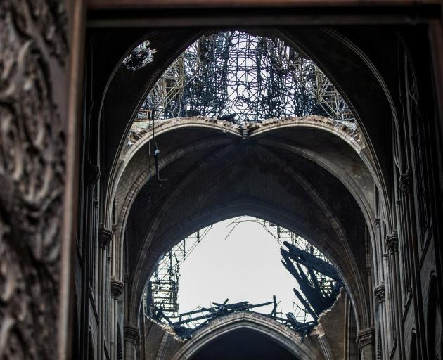 A view of the damaged roof inside Notre-Dame de Paris in the aftermath of a fire that devastated...