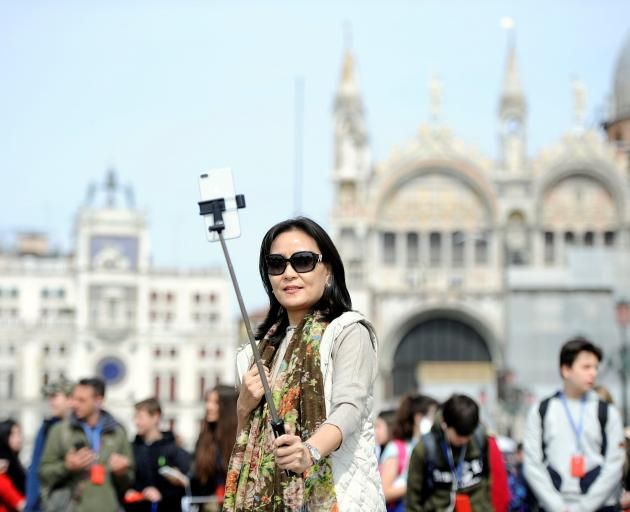 In Venice resentment towards tourists has led to anti-tourism protests. Photo: Reuters