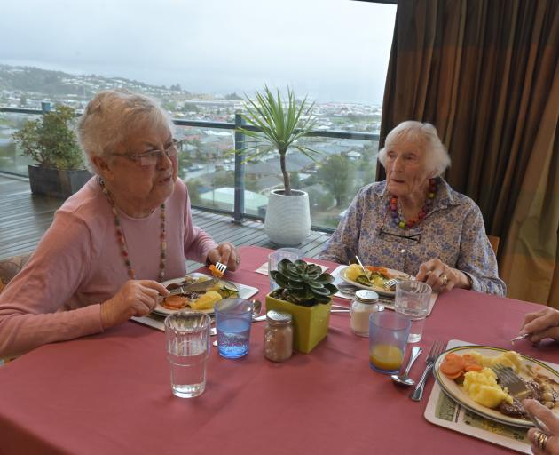 Residents Barbara Chilman (left) and Betty Kensington enjoy their lunch in the Rest Home at...