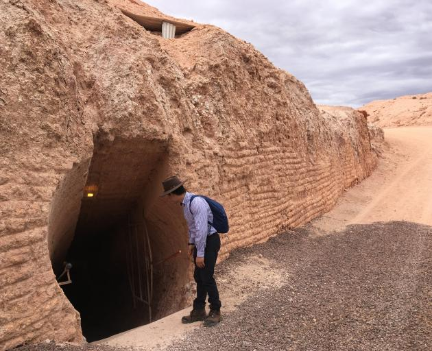 A Ghan host looks down into the underground Serbian Orthodox Church at Coober Pedy. PHOTO: PAM JONES
