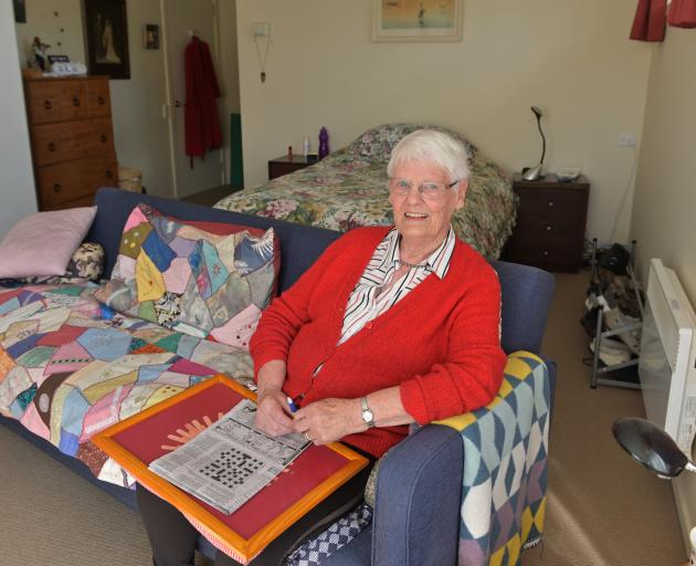 Resident Shirley Erwin in her unit at Abbeyfield Retirement Village.