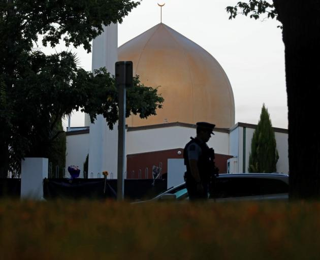 An officer stands guard in front of the Al Noor mosque in Christchurch. Photo: AP