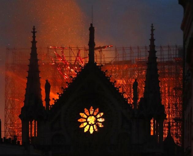 Flames and smoke rise from Notre Dame cathedral as it burns in Paris. Photo: AP
